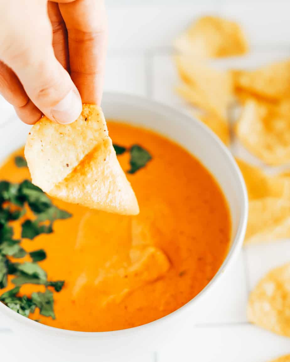 Vegan queso dip made with cashews and roasted tomatoes